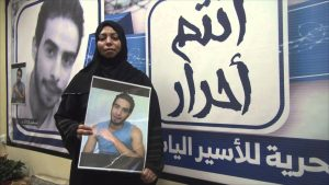Mother of Elias Al-Mulla Carrying his photo